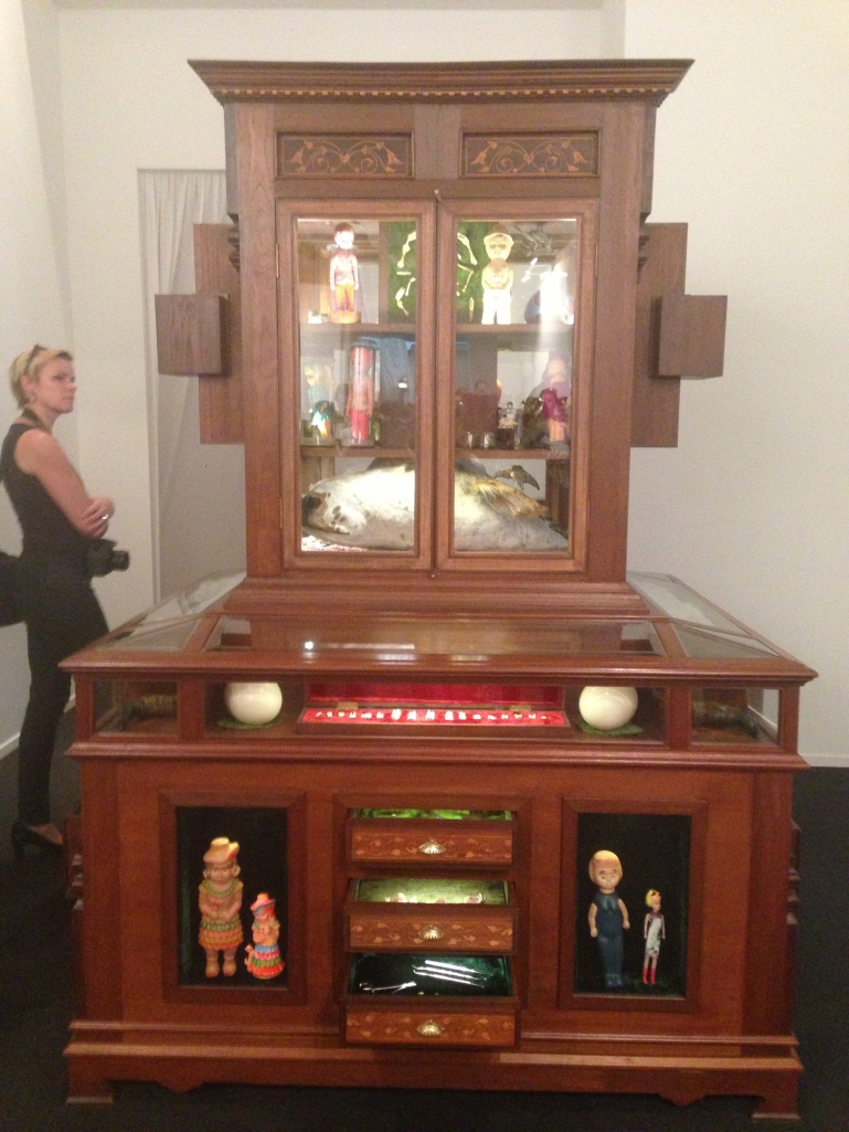 Huma Mulji 'The Miraculous Lives of This and That' Medium : Wooden cabinet, various objects including taxidermy animals, plastic toys and dust. Courtesy: Al Mahha Art Blog