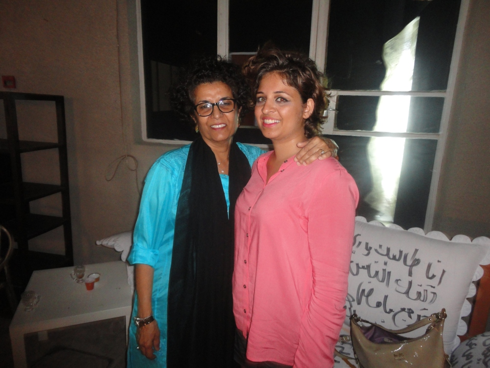 with artist Fatma Lootah at SIKKA, writings on sofas were also by Lootah!