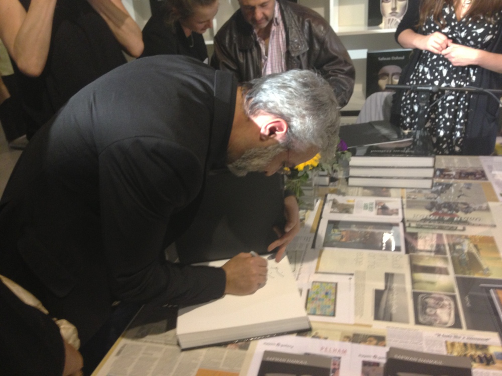 Artist Safwan Dahoul signing his book. Courtesy: Al Mahha Art Blog