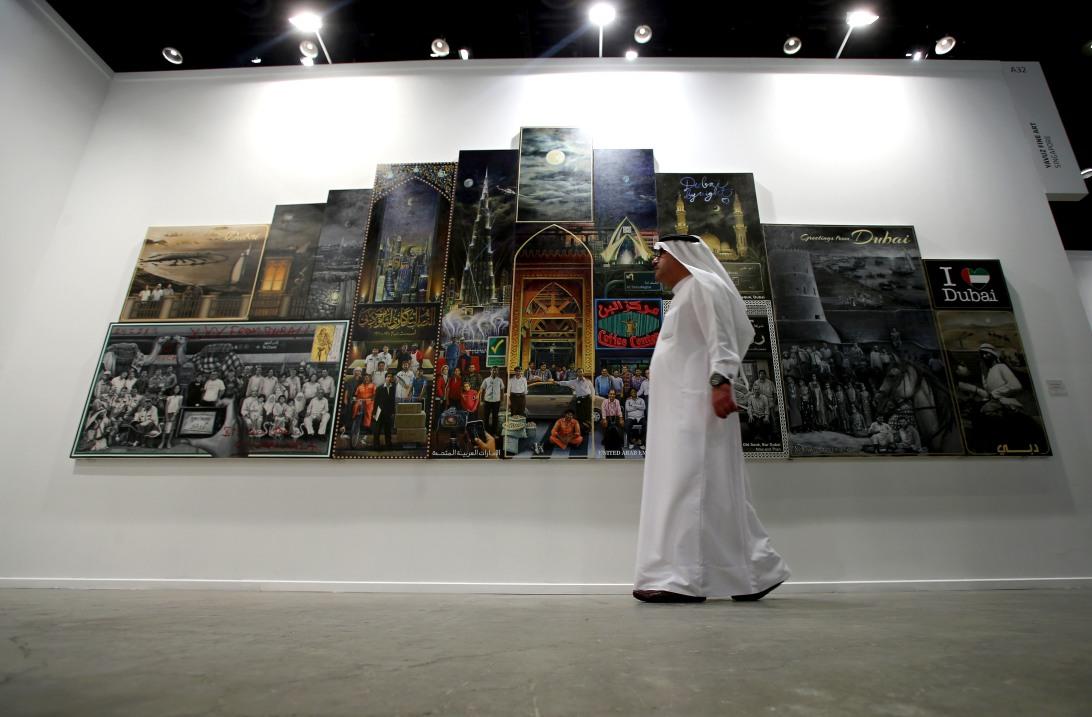 A visitor walks past the work of Thai artist Navin Rawanchaikul during  Art Dubai 2014. Courtesy: Getty Images for Art Dubai.